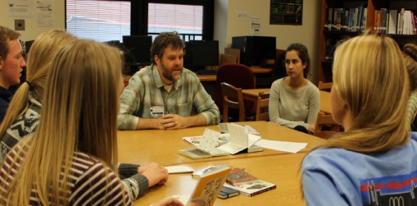 Students gather around Jeffrey Brown to learn about graphic novels at Literary Festival on Nov. 14