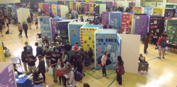 Students view what their peers worked on for four weeks at the 2014 Senior Project Exhibition    (New Trier website)