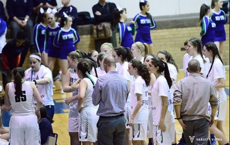 Girls basketball squeaks past Evanston