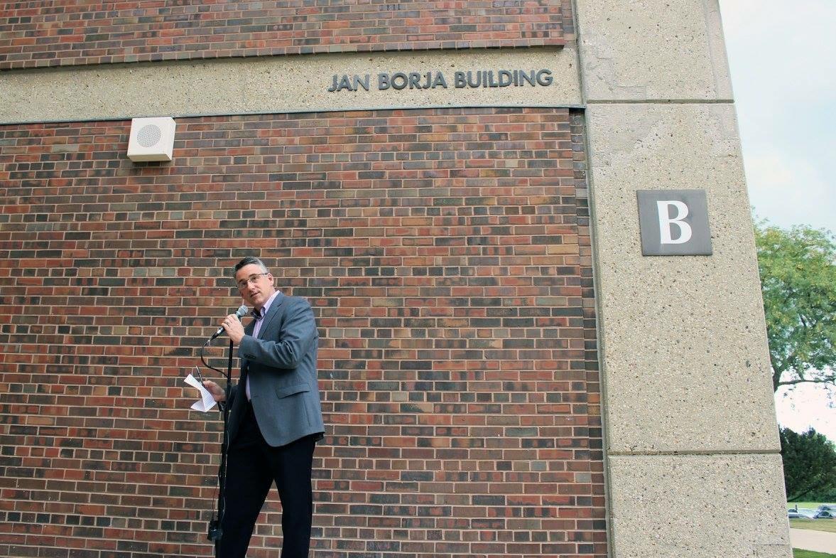 Superintendant Paul Sally dedicates Jan Borja building