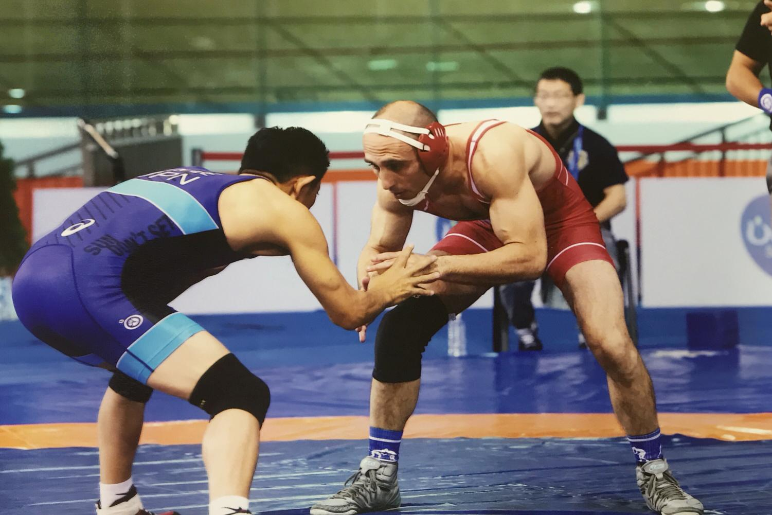 Coach Tadelman wrestling at the world championships    | Tadelman
