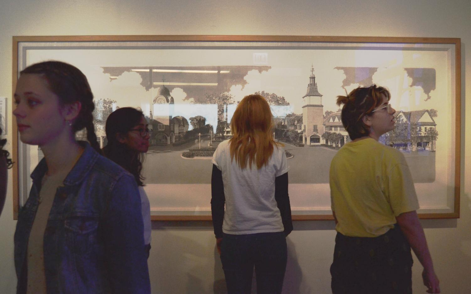 Students browse the newly opened Ann Brierly art gallery located on the second floor of the west wing
