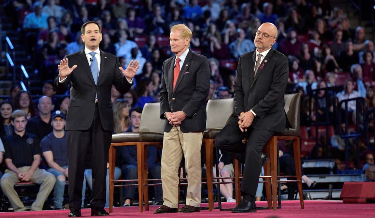 Senator Rubio (L), Senator Bill Nelson, and Representative Ted Deutch during a CNN town hall meeting  |  AP Images
