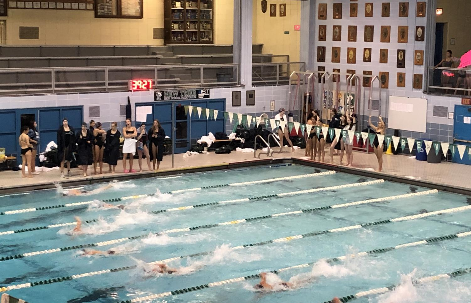 Trevian and Rambler swimmers compete in the varsity 200-meter freestyle relay at the Sept. 20 meet