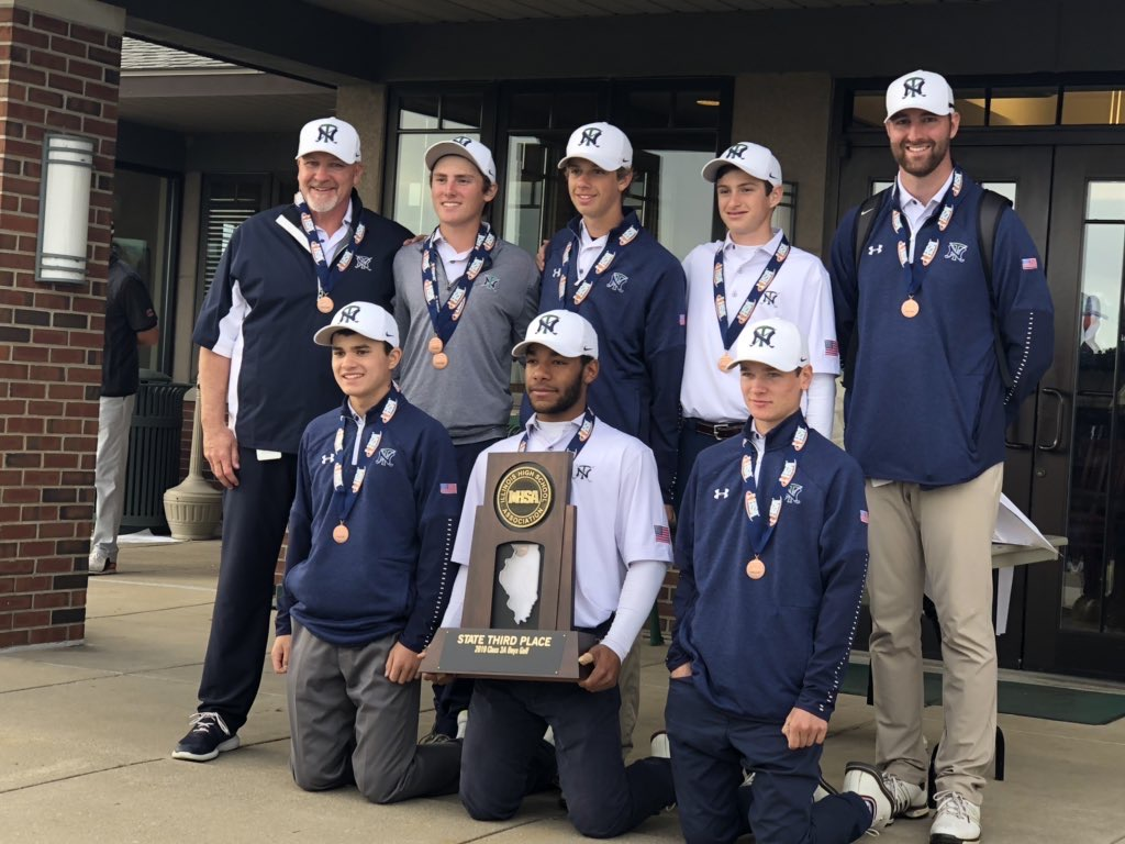 The boys golf team poses with their bronze medals after state on Oct. 19