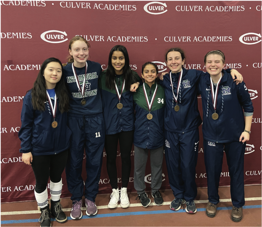 The women's sabre team poses with their gold medals following the Midwest Open on Dec. 15