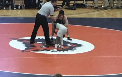 Varsity wrestling rallies for 40-33 victory at Evanston