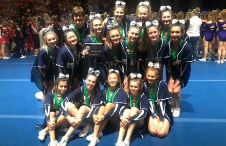 Cheer team poses following the ICCA championship