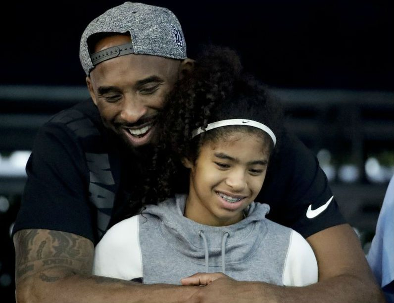 Bryant with 13-year-old daughter, Gianna, who also passed in the crash