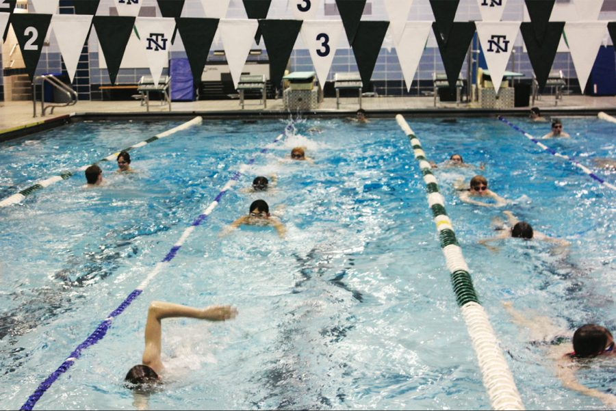 Members of the team during a practice after the Evanston meet, they will soon begin preparing for state