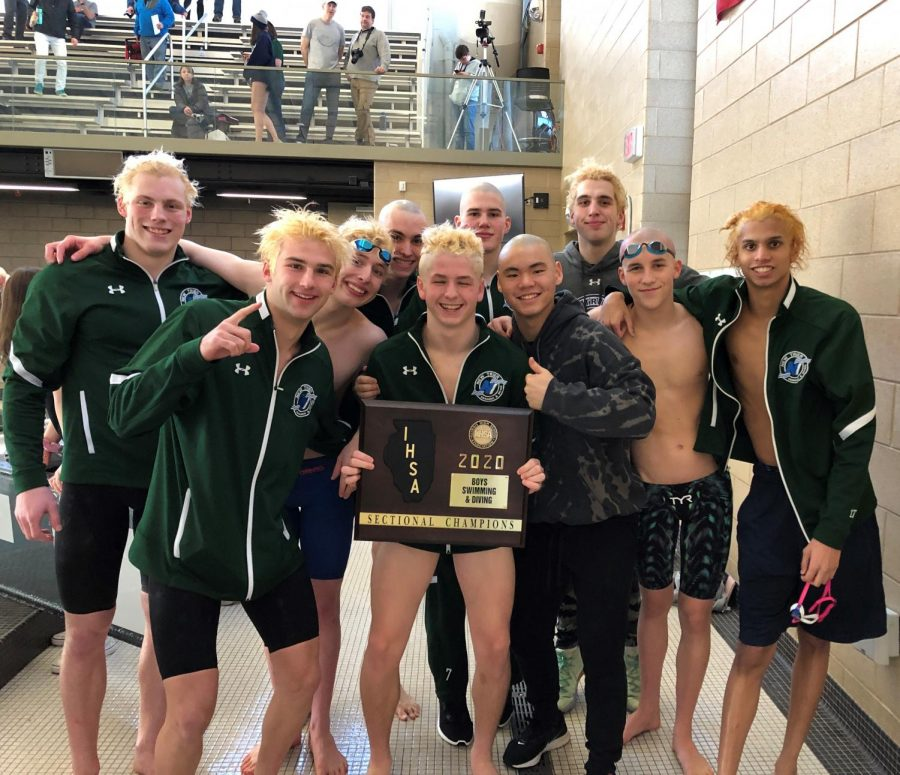 Boys swimming and diving celebrate 1st place win at Niles North IHSA Sectionals on Feb. 22