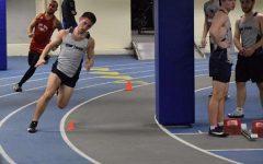 Junior Ben Yoder running at a New Trier open meet this season
