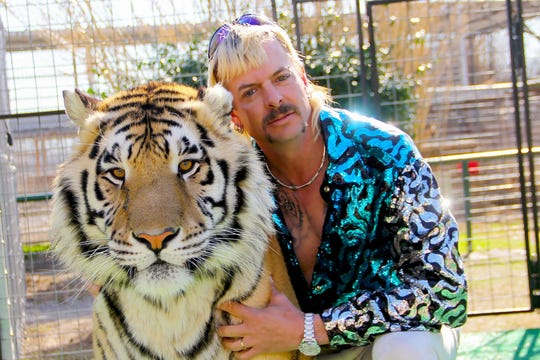 "Joe Exotic with one of his tigers from the Netflix show ""Tiger King"""