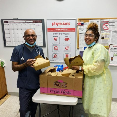 Doctors and nurses at Visiting Physicians in Chicago's Bucktown neighborhood, a COVID-19 testing center, receive 20 meals from Fab Food Chicago and Meals for Chicago