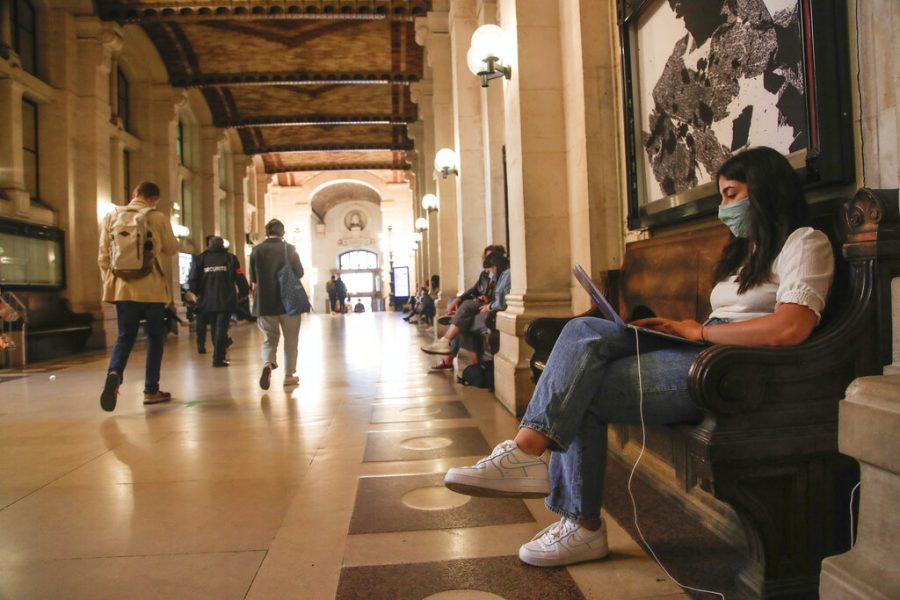 European students make their way across campus (what school?) add more info about picture and connect to story