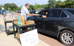 Science teacher John Miller distributes Physics materials on Trevian Way
