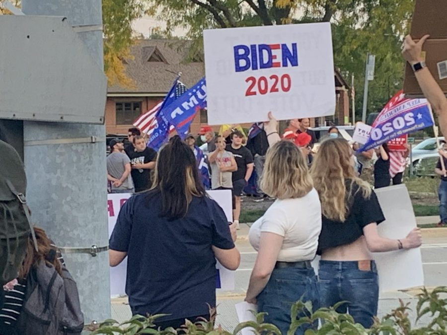 Biden and Trump voters proudly wave their flag at the Sep. 25 rally in Northbrook