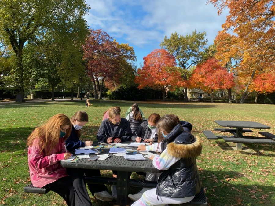 The group Students Demand Action Wilmette gathers for a post-card writing event