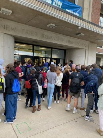 Students gather around the front entrance of the school waiting to be let in for the Oct. 14 SAT