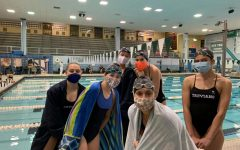 Swimmers pose at meet vs. Evanston on Sept. 25