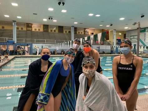 Swimmers pose at meet vs. Evanston on Sept. 25