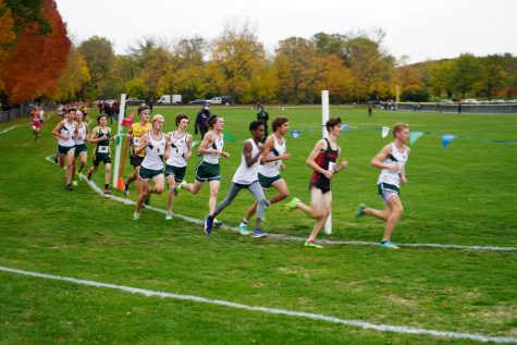 The varsity team runs the three-mile race at Duke Childs Fields on Oct. 17. The JV team was unable to compete because they were quarantining after a positive test result