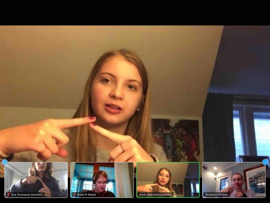 Emily+Waechtler+demonstrates+the+sign+for+%22where%22+during+a+recent+meeting+of+the+Sign+Language+Club