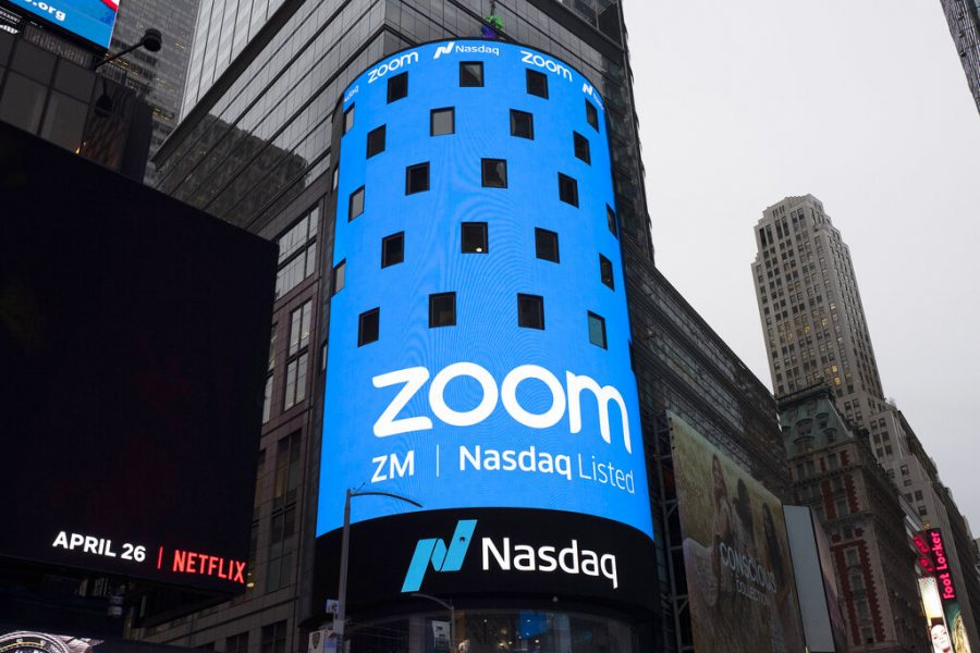 A sign for Zoom Video Communications appears on a Times Square billboard before the company's IPO on the Nasdaq in April 2019