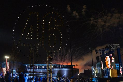 "Drones spelling out ""46"" light up the sky as President-elect Biden appears on a video monitor after giving his acceptance speech"