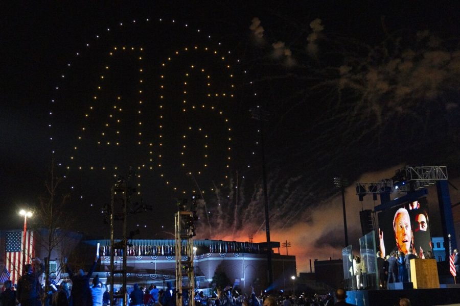 """Drones spelling out """"46"""" light up the sky as President-elect Biden appears on a video monitor after giving his acceptance speech"""