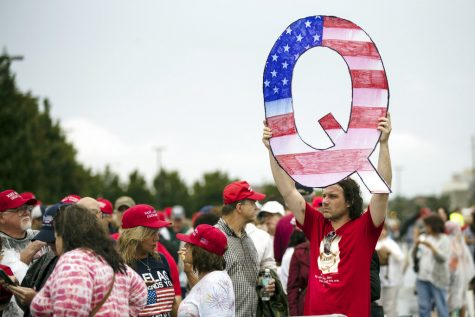 QAnon will be here long after Trump is gone (AP Photo/Matt Rourke, File)