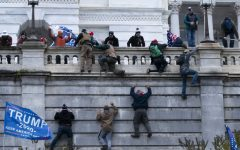 Trump supporters and right wing rioters climb the West wall of the Capitol, attempting to nullify President-elect Biden's victory in the 2020 election