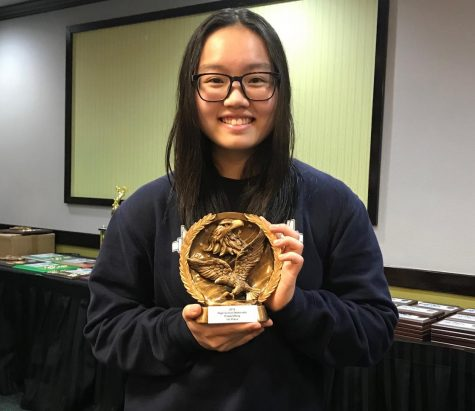 Song holding her first place award from the 2019 Powerlifting High School Nationals