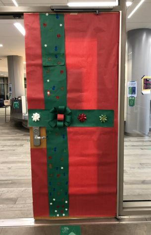 Doors around school, including this one to the library commons, were wrapped in holiday cheer in December by Transition Program students