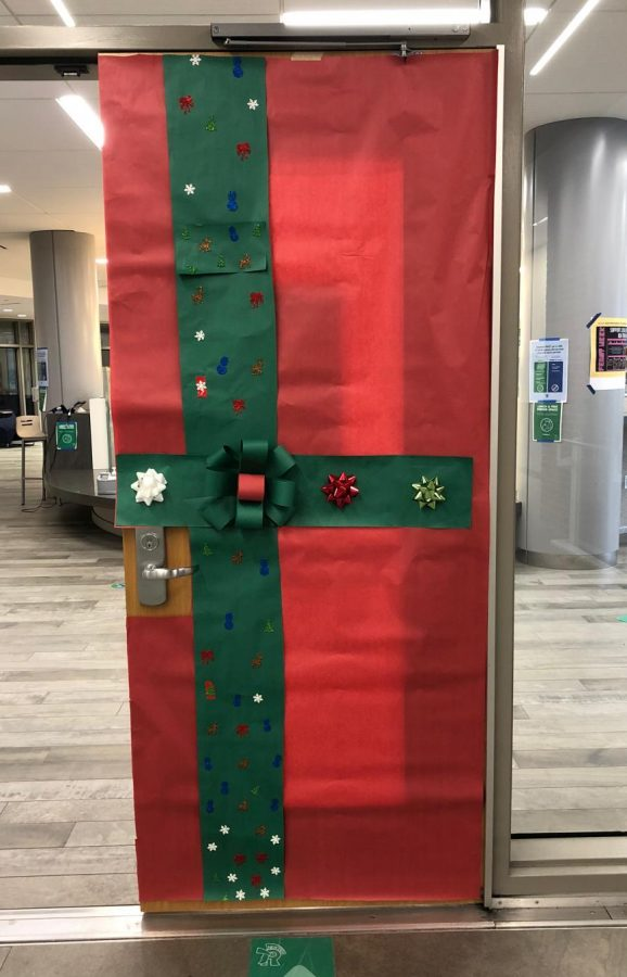 Doors+around+school%2C+including+this+one+to+the+library+commons%2C+were+wrapped+in+holiday+cheer+in+December+by+Transition+Program+students++
