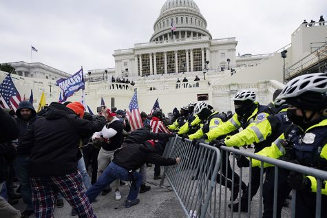 Trump supporters try to break through a police barrier at the Capitol on Jan. 6. On Jan. 7 many teachers held discussions in class about the events