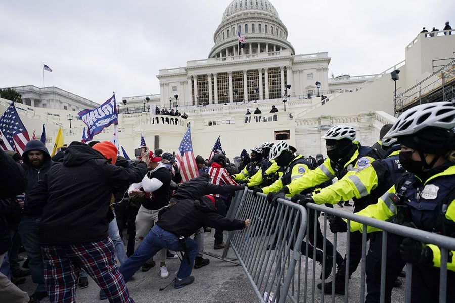 Trump+supporters+try+to+break+through+a+police+barrier+at+the+Capitol+on+Jan.+6.+On+Jan.+7+many+teachers+held+discussions+in+class+about+the+events