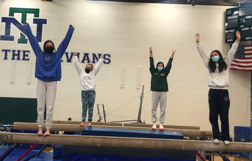 Girls gymnastics team celebrates the resumption of the sports season