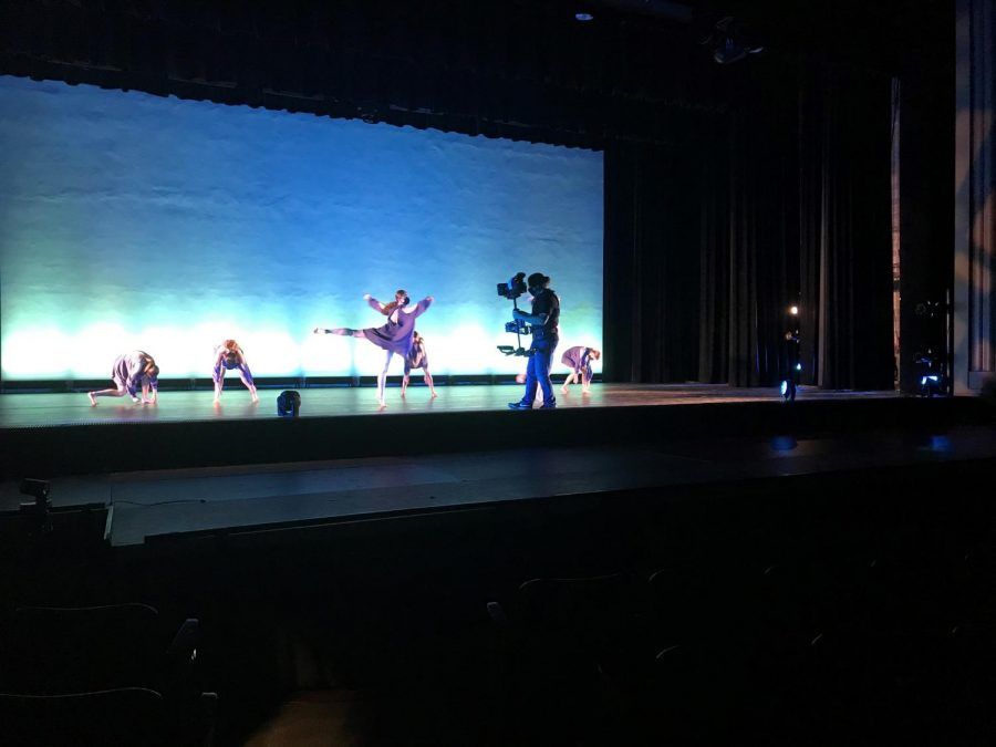 On stage, cameraman Guy Rhodes navigates through a dance choreographed by senior Madeline Brown offering viewers an up-close perspective unique to that of a typical dance performance.