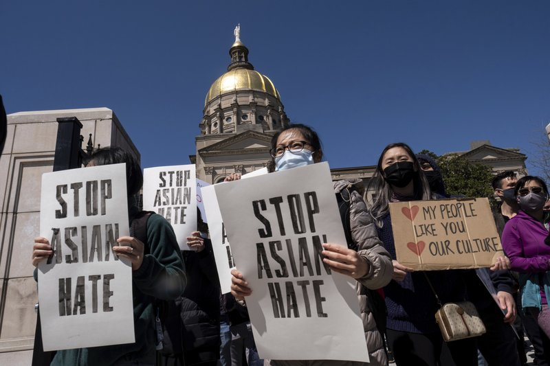 """Demonstrators gather during a """"Stop Asian Hate"""" rally outside Georgia"""