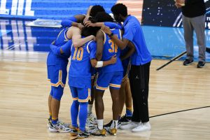 UCLA players huddle on the court after their heartbreaking Final Four loss against Gonzaga